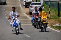 Boys on motocycles in Kuala Tahan