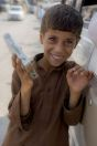 Little boy selling chewing gum, Qalandarabad