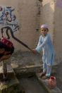 Kid at the well, Paharpur