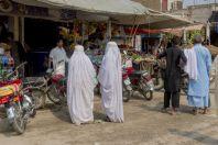 Women in burka, Paharpur